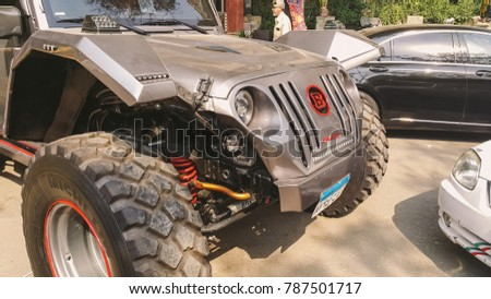 Giza, Egypt - 2016 - Modified Jeep Wrangler with huge rims and wheels parked along side old cars in the streets of Giza, Egypt.