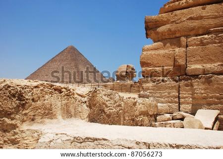 giza pyramid and sphinx - stock photo