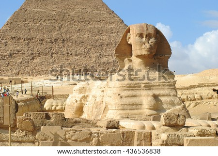 Giza pyramid with Spinx statue over blue sky background in Egypt - stock photo