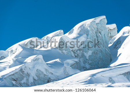 glacial crevasse and ice structures in a glacier above saas fee, valais, switzerland - stock photo