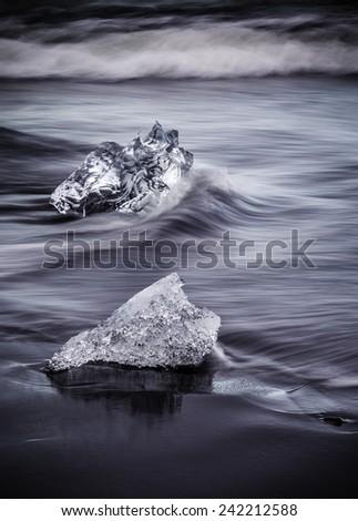 Glacial Ice on the beach at Jokulsarlon, Iceland - stock photo