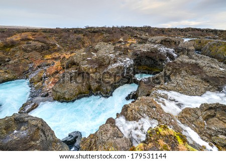 Glacial River Pool, Barnafoss, Iceland. Barnafoss, a waterfall, also known as Bjarnafoss, is near Hraunfossar which burst out of Hallmundarhraun which is a great lava plain. - stock photo