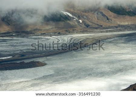 Glacier and Mountainside, Kluane National Park, Yukon - stock photo