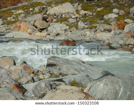 Glacier ice pushed by the stream of a river - stock photo