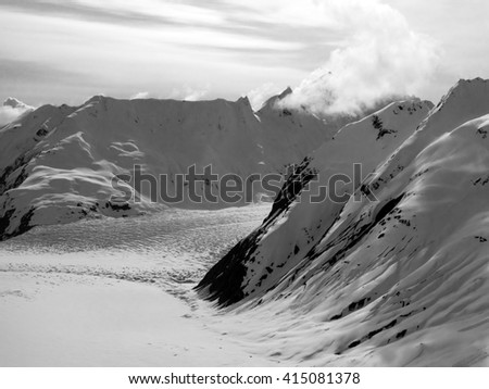 Glacier in the mountains of Southeast Alaska in early spring in black and white.