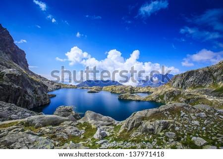 Glacier lake Cornu in the French Alps in summer - stock photo