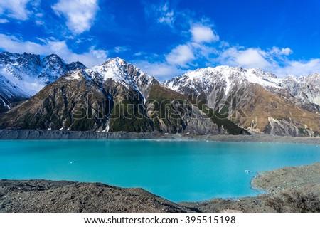 Glacier lake with turquoise blue water and mountains landscape. Winter mountain landscape with snow and glacier lake. Tasman glacier, Aoraki - Mount Cook National Park, New Zealand - stock photo
