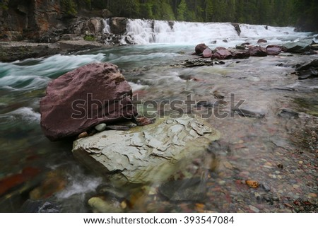 Glacier National Park Waterfall - stock photo