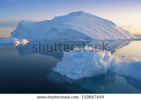 Glaciers and icebergs of Greenland. Travel among Disko Bay ices. - stock photo