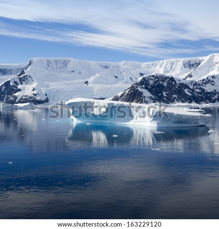 Glaciers and icebergs. Travel on deep pure waters among ices of Antarctica. Fantastic snow landscapes.