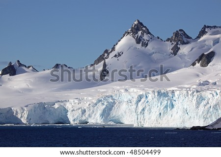 Glaciers and mountains of Antarctica - stock photo