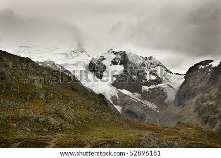 Glaciers on the high mountains near the Suestenpass in the Swiss Alps, in early autumn.