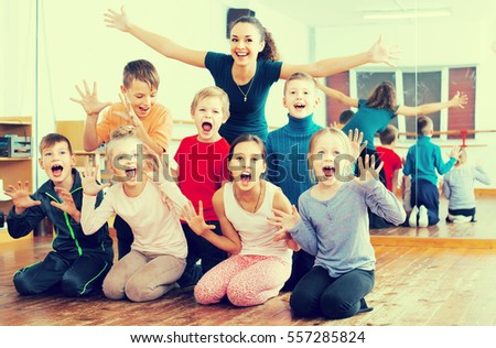 Glad children  in dance studio smiling and having fun