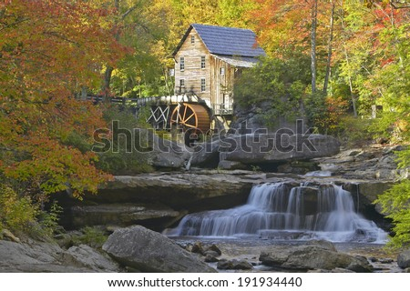 Glade Creek Grist Mil and autumn reflections and water fall in Babcock State Park, West Virginia - stock photo