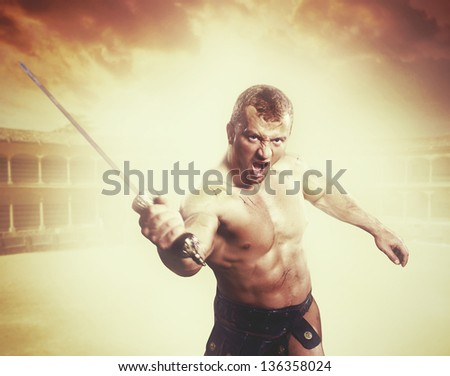 Gladiator attacking on rome arena - stock photo