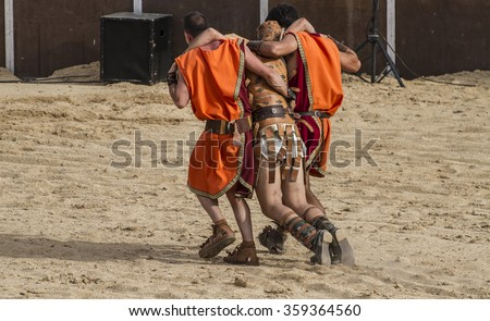 gladiator fights in the arena of the Roman circus, representation - stock photo