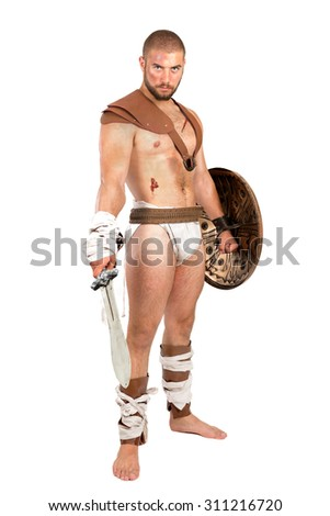 Gladiator posing with shield and sword isolated in white - stock photo
