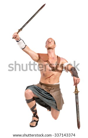 Gladiator posing with swords isolated in white - stock photo