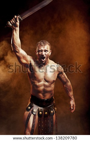 Gladiator with sword in smoke - stock photo