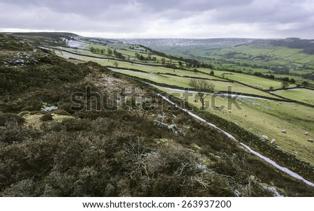 Glaisdale, Yorkshire, UK. Snow over the noth York Moors National Park showing the valley at Fryup, farmland, and sheep,  and the undulating landscape near Glaisdale dale, Yorkshire, UK. - stock photo