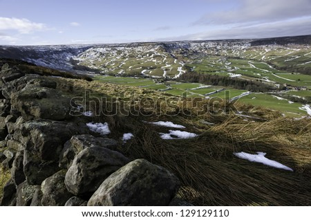 Glaisdale, Yorkshire, UK. View across the dale and a dry stone wall at Fryup in the midst of the North York Moors on a fine winter's morning showing the rolling landscape, Glaisdale, Yorkshire, UK. - stock photo