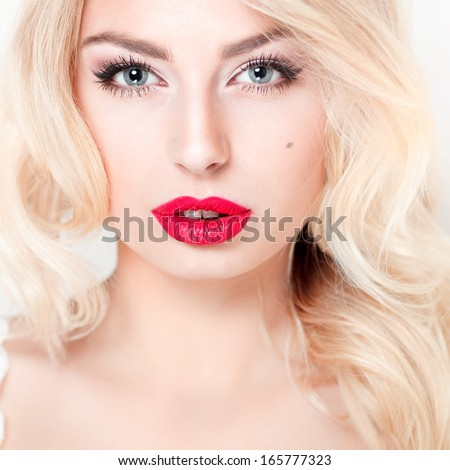 glamor closeup portrait of beautiful sexy blonde model with bright makeup, with red lips, with perfect clean skin in studio