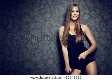 Glamor Portrait of sexy woman on grey background - stock photo