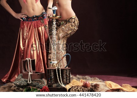 Glamor portrait with a hookah pipe and smoke