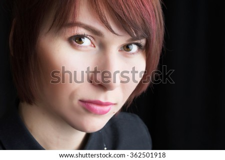 Glamor woman face portrait with red highlights hair, beautiful female isolated on black background, stylish sexy look, young lady studio shot