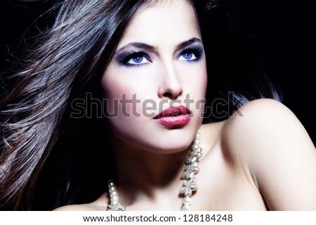 Glamorous beauty blue eyes woman portrait, dark background, studio shot - stock photo