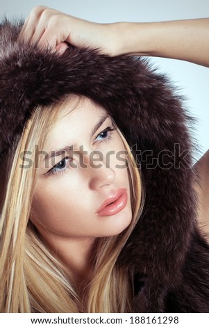 Glamorous blond woman fashion fur style.  attractive young model studio photoshoot - stock photo