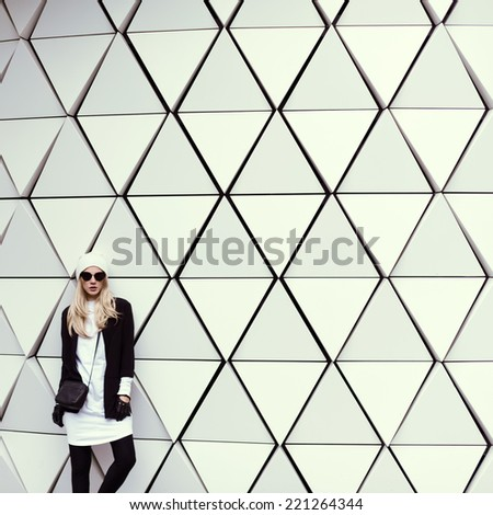 Glamorous Blonde standing at the wall. Urban Fashion  Style - stock photo