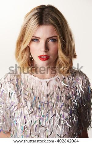 Glamorous blonde woman, portrait to camera, vertical - stock photo