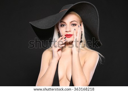 Glamorous blonde woman with fashion makeup posing in hat  - stock photo