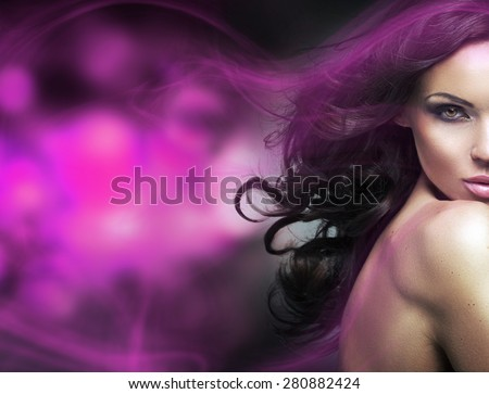 Glamorous brunette beauty on fantasy background