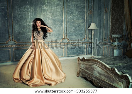 Glamorous Brunette Woman in a Bedroom in Royal Interior