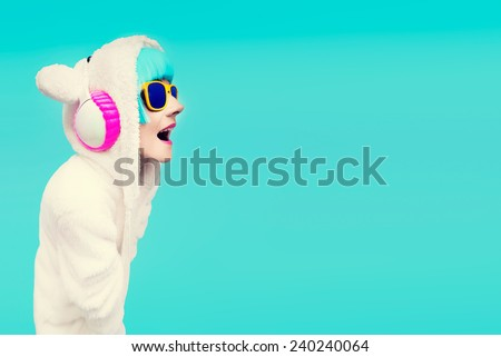Glamorous fashion Girl in bright clothes art background listening to music. All shades of music - stock photo