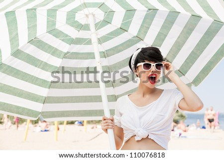 glamorous girl in retro style by color umbrella - outdoors - stock photo