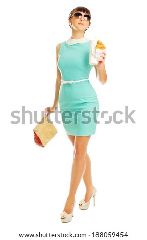 Glamorous girl in turquoise dress holds snacks isolated - stock photo