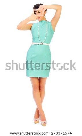 Glamorous girl in turquoise dress shows frame gesture isolated - stock photo