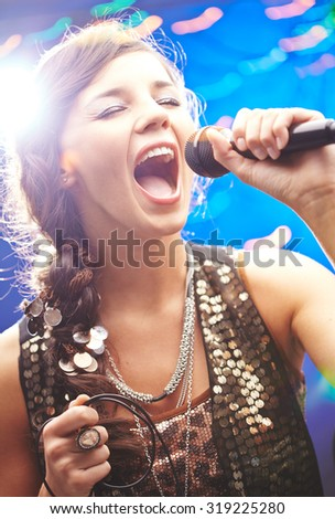 Glamorous girl singing emotional song