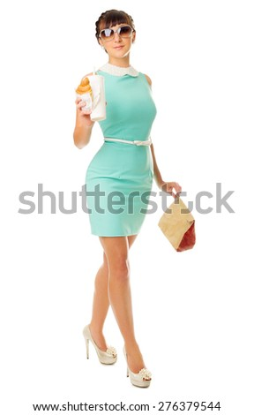 Glamorous girl with plastic cup and snacks isolated - stock photo