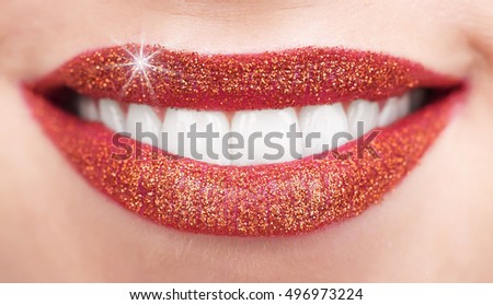 Glamorous glossy female lips and teeth.