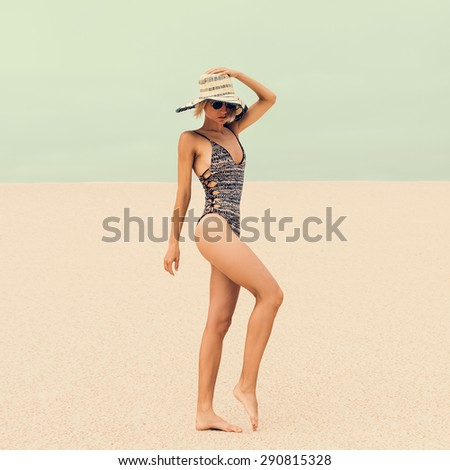 Glamorous Lady in fashionable Swimsuit and Accessories at the beach on Vacation - stock photo