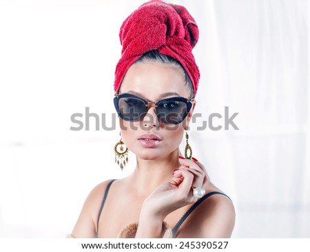 Glamorous lady in sunglasses and a towel on her head