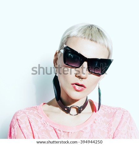 Glamorous Lady stylish Haircut, stylish Accessories. Fashion Jewelery and Sunglasses.