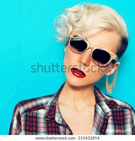 Glamorous Lady with fashionable Hairstyle and trendy Sunglasses - stock photo