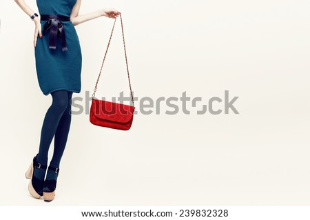 Glamorous Lady with trend accessories. Green and red combination in clothing - stock photo