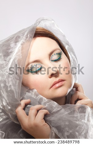Glamorous made-up eyes of a veiled woman - stock photo