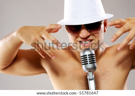 Glamorous man sing a song - stock photo